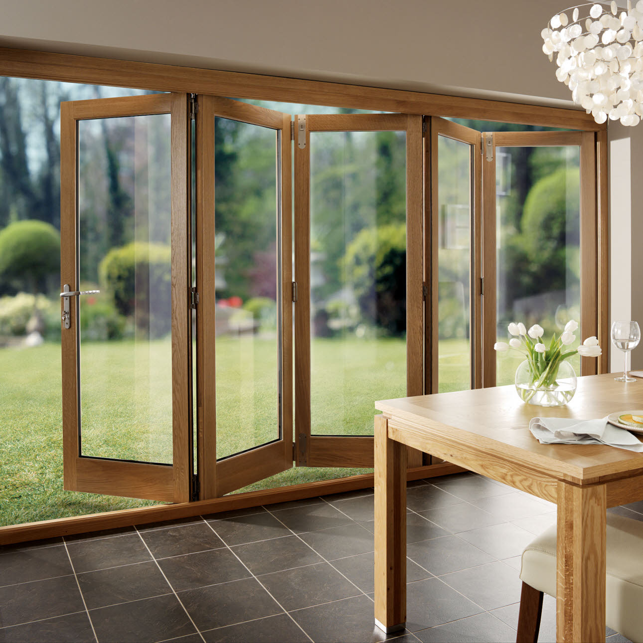 Timber folding kitchen door, opening towards garden