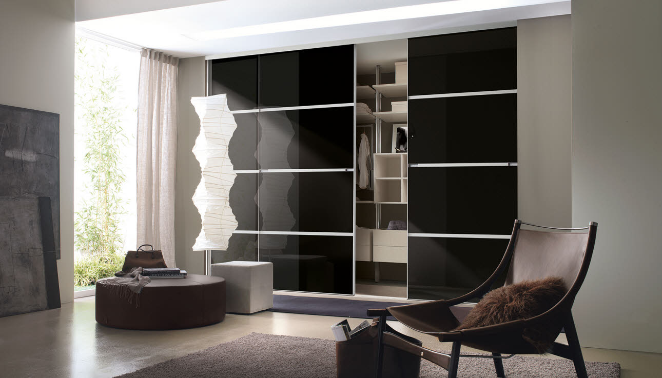 Fitted bedroom wardrobe with black sliding doors