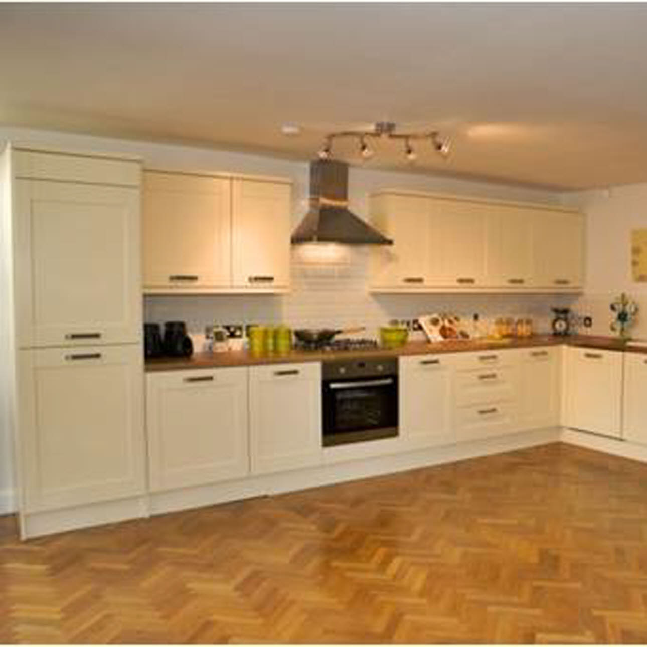 Cream Magnet fitted kitchen, wooden floor