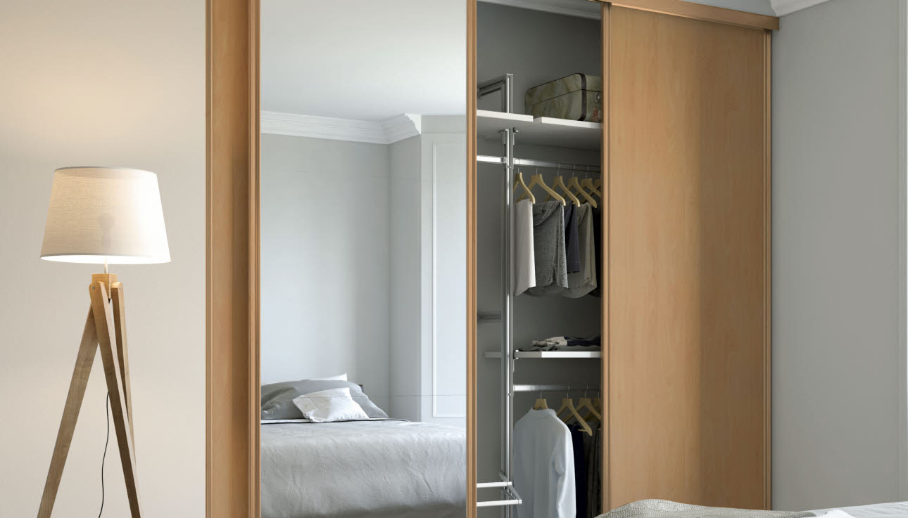 Fitted wooden bedroom wardrobe with full length mirror