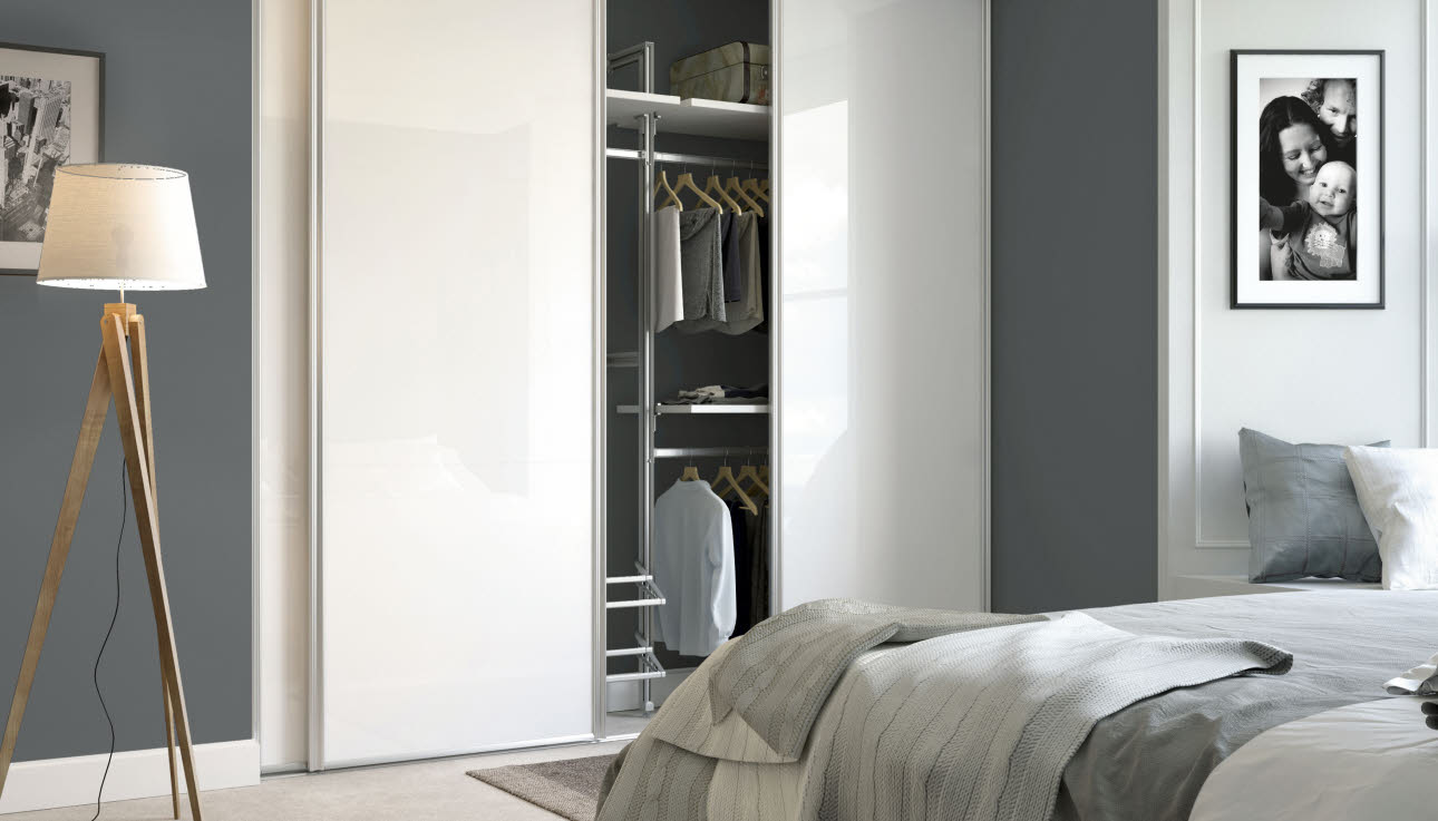 White glass bedroom fitted wardrobe with internal sliding door