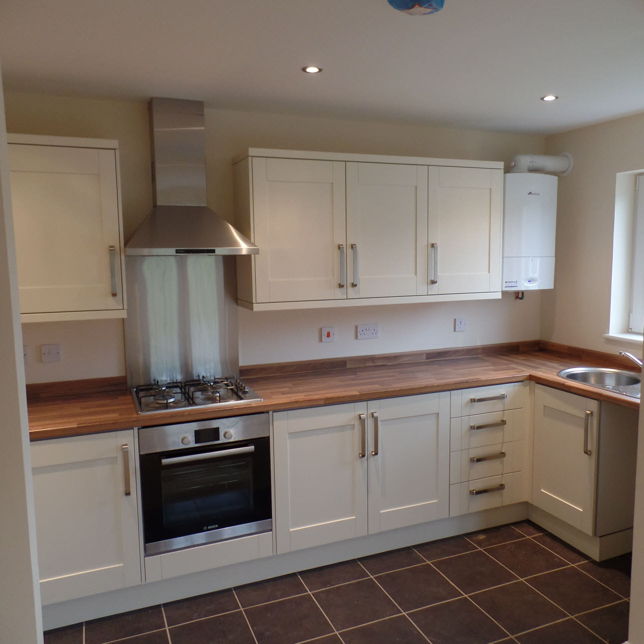 Cream Magnet kitchen installed at Westrop Homes