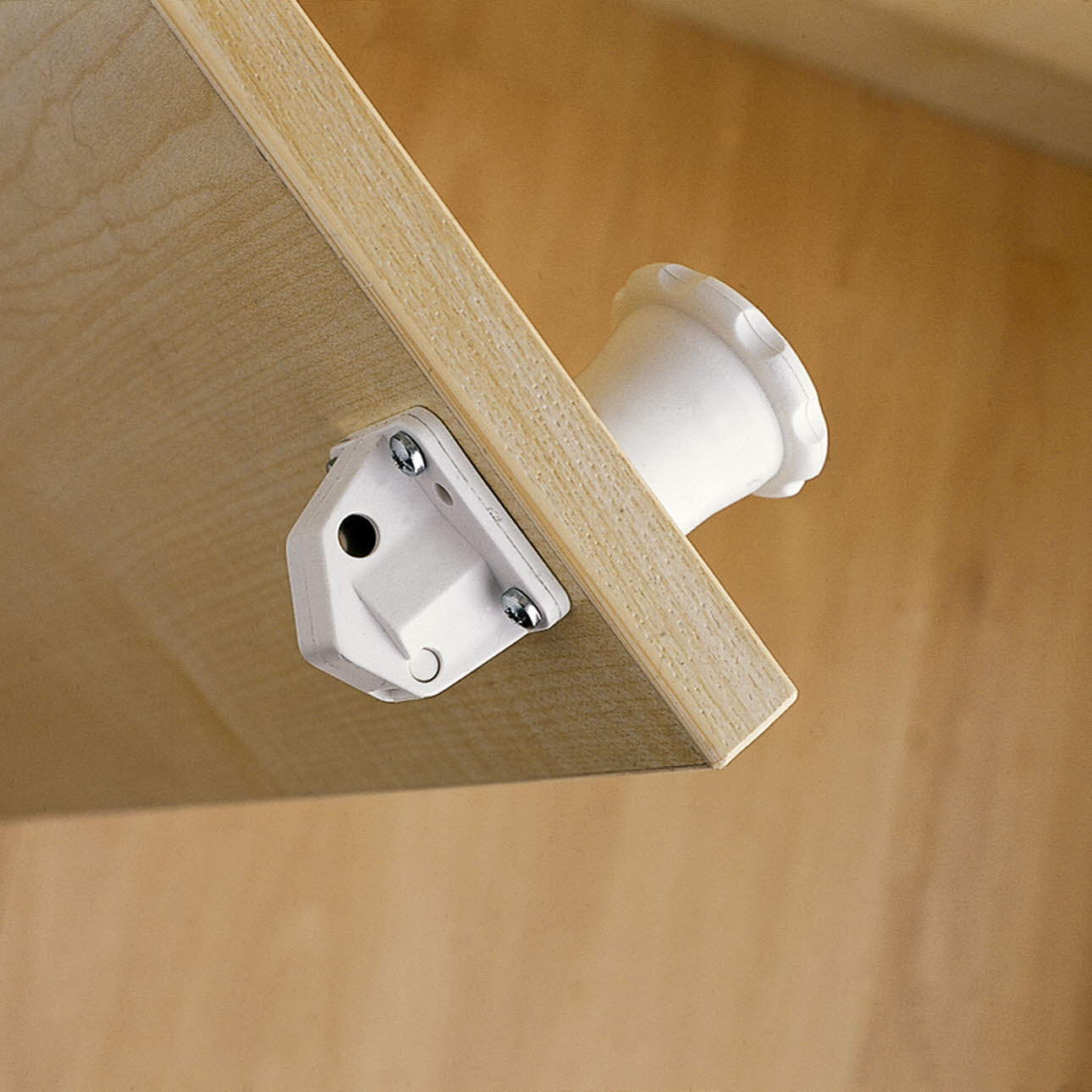 Close up, white magnetic safety catch