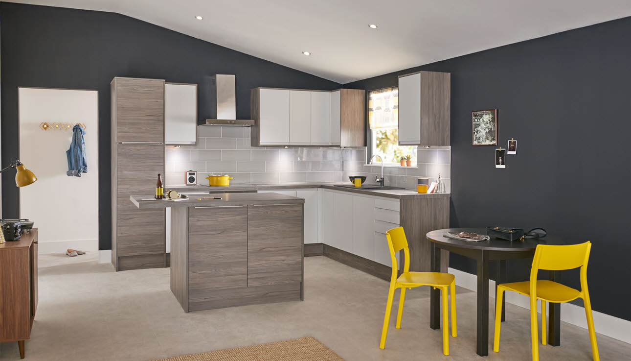 stylish shade of grey with integrated handles makes this kitchen a ...
