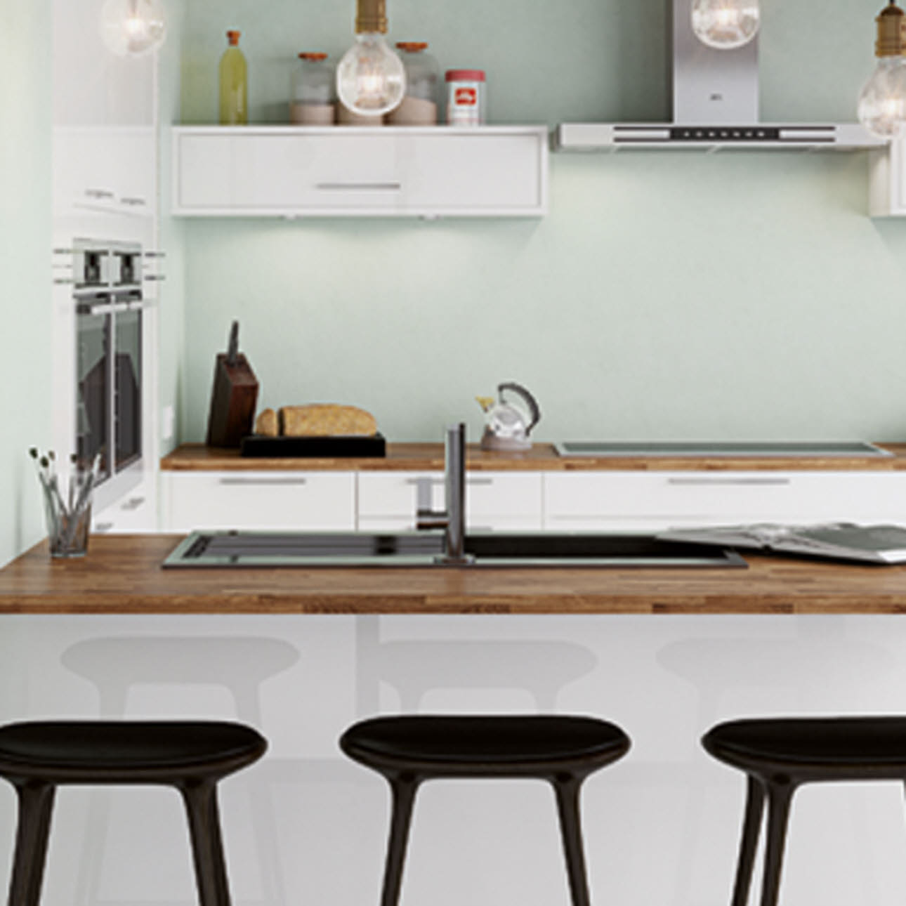 Cream kitchen island with wooden worktop and three black stools