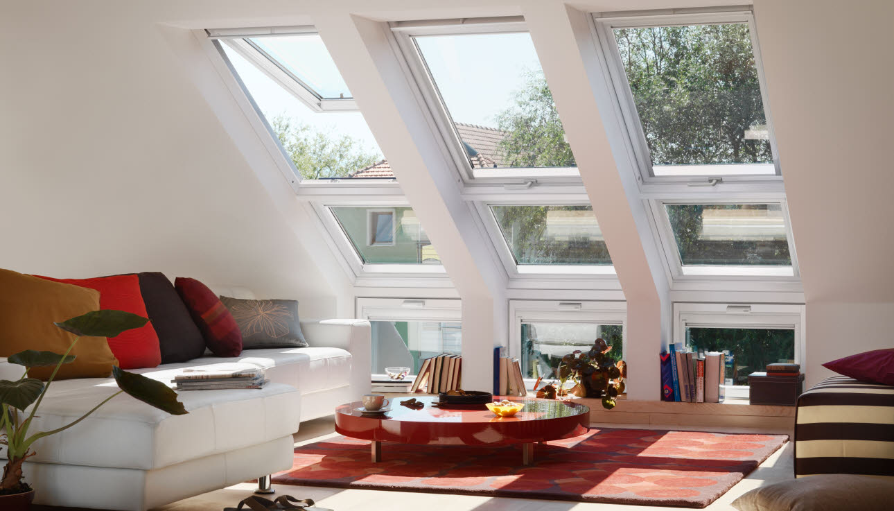 Three sloping combination Velux windows above sofa and seating area