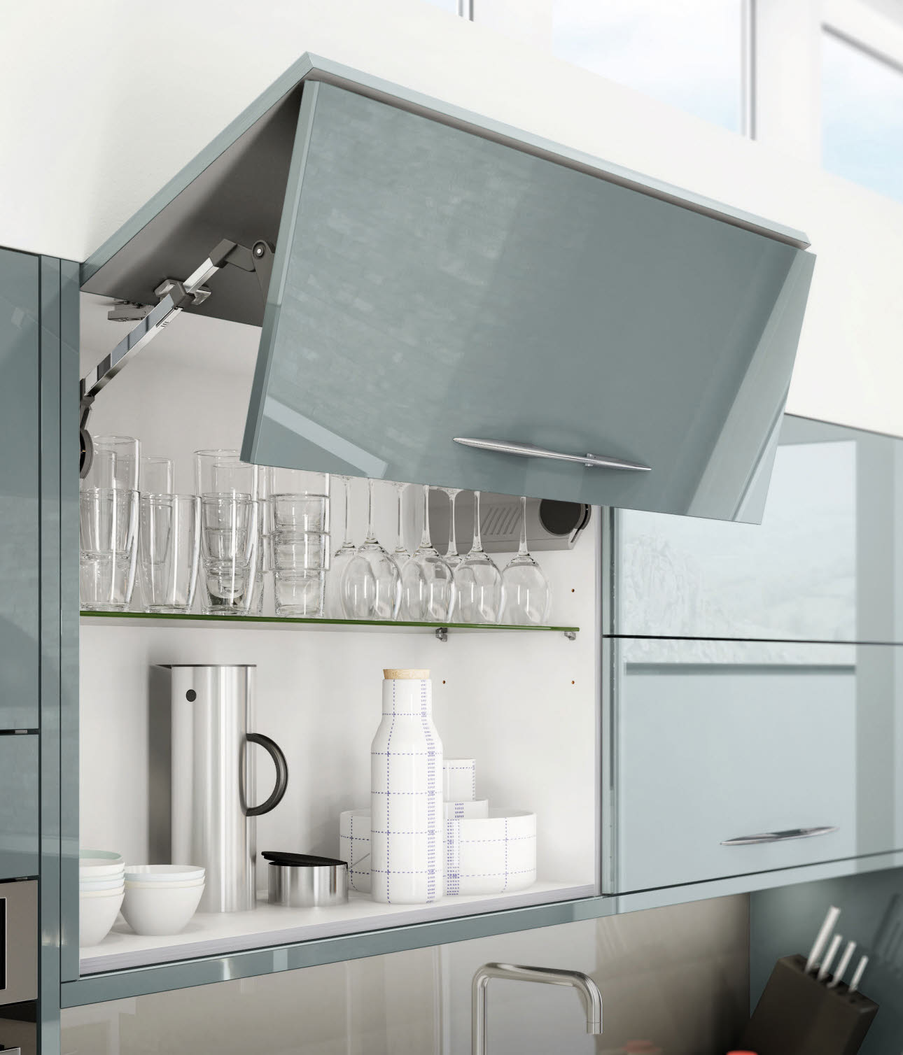 Fusion Blue kitchen wall cupboard, lift up door open revealing glasses