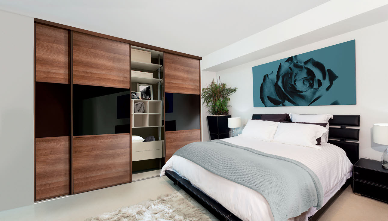 Black and walnut fitted bedroom wardrobe with sliding doors