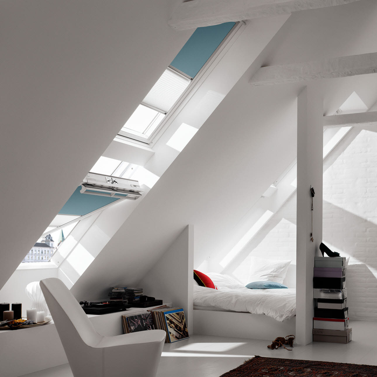 Sloping Velux bedroom windows, turquoise blinds, white bedroom