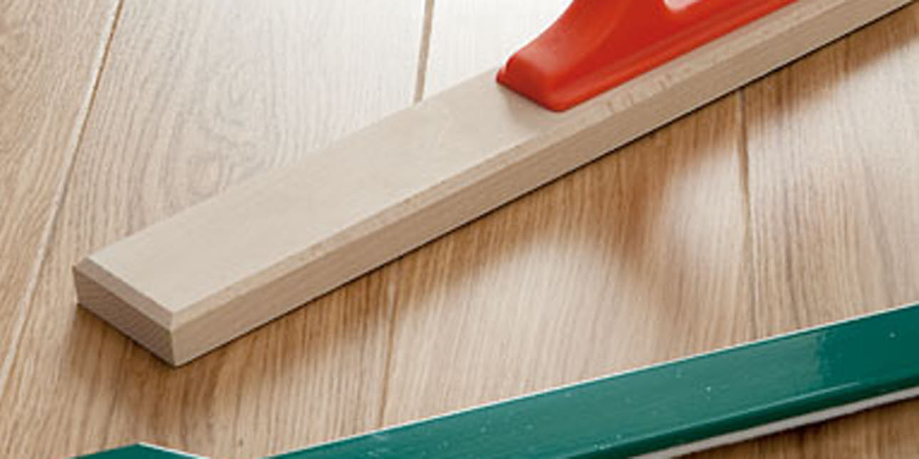 Wood flooring and installation tools, close up