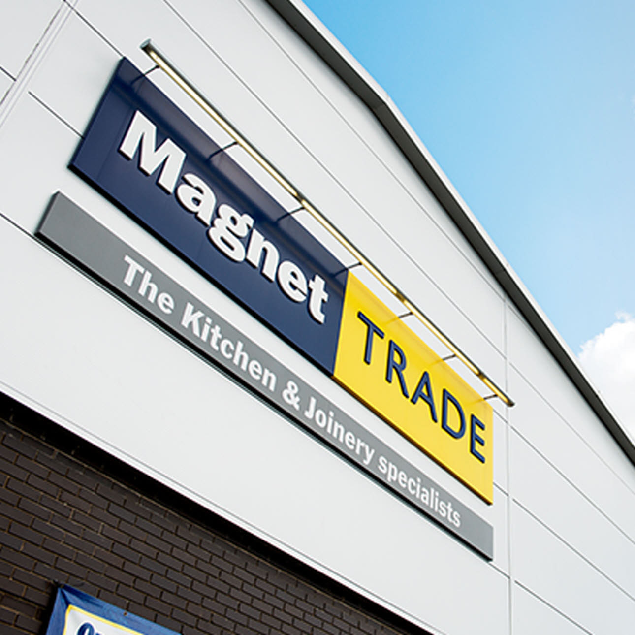 Magnet Trade logo on external shot of store