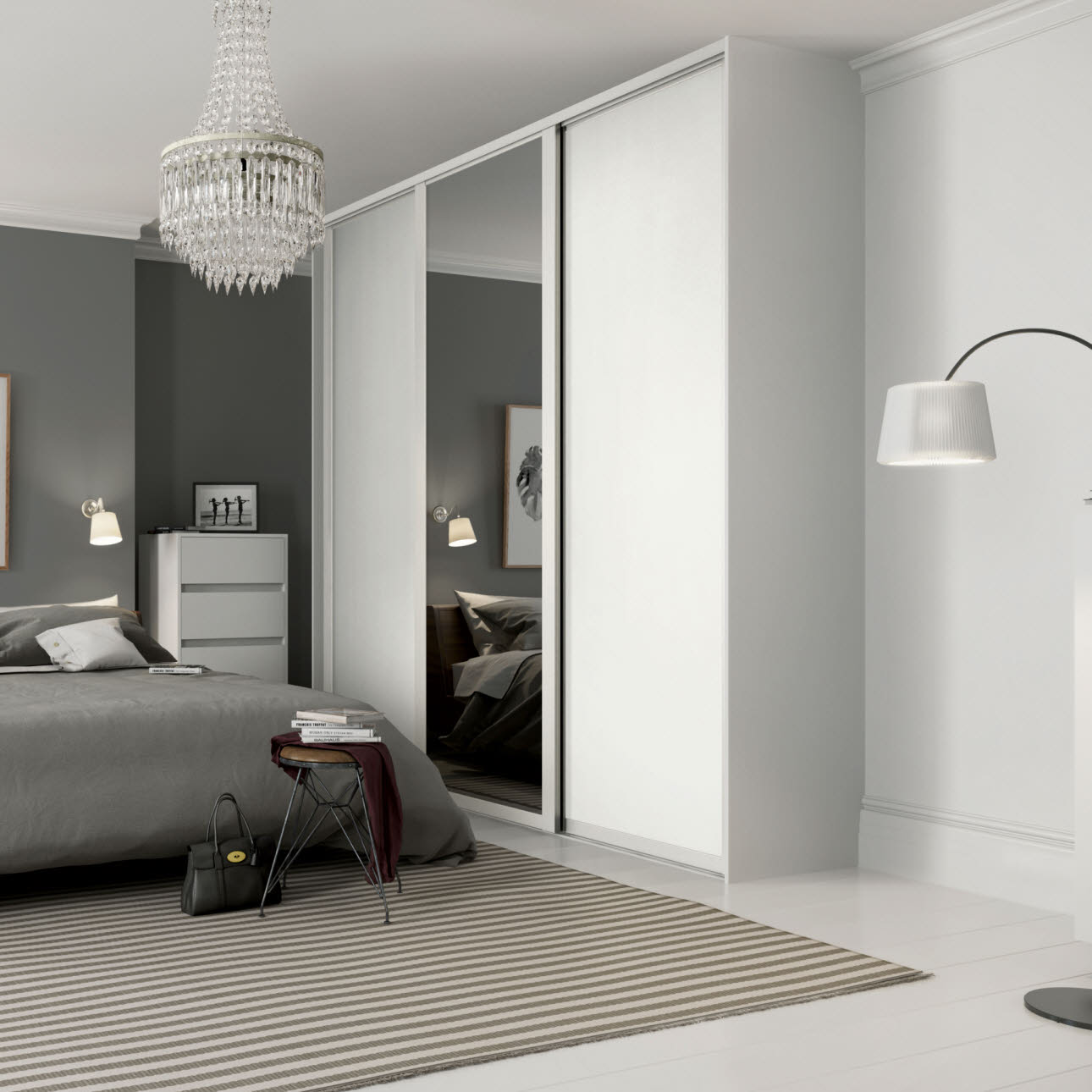 Grey and white bedroom, white fitted wardrobe with central full length mirror
