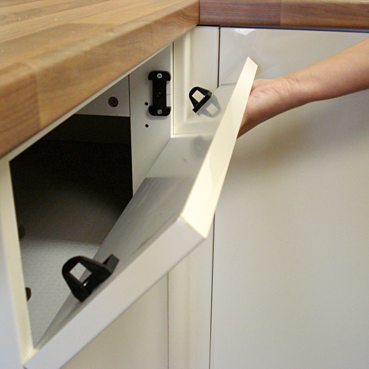 Close up of kitchen unit panel lock mechanism