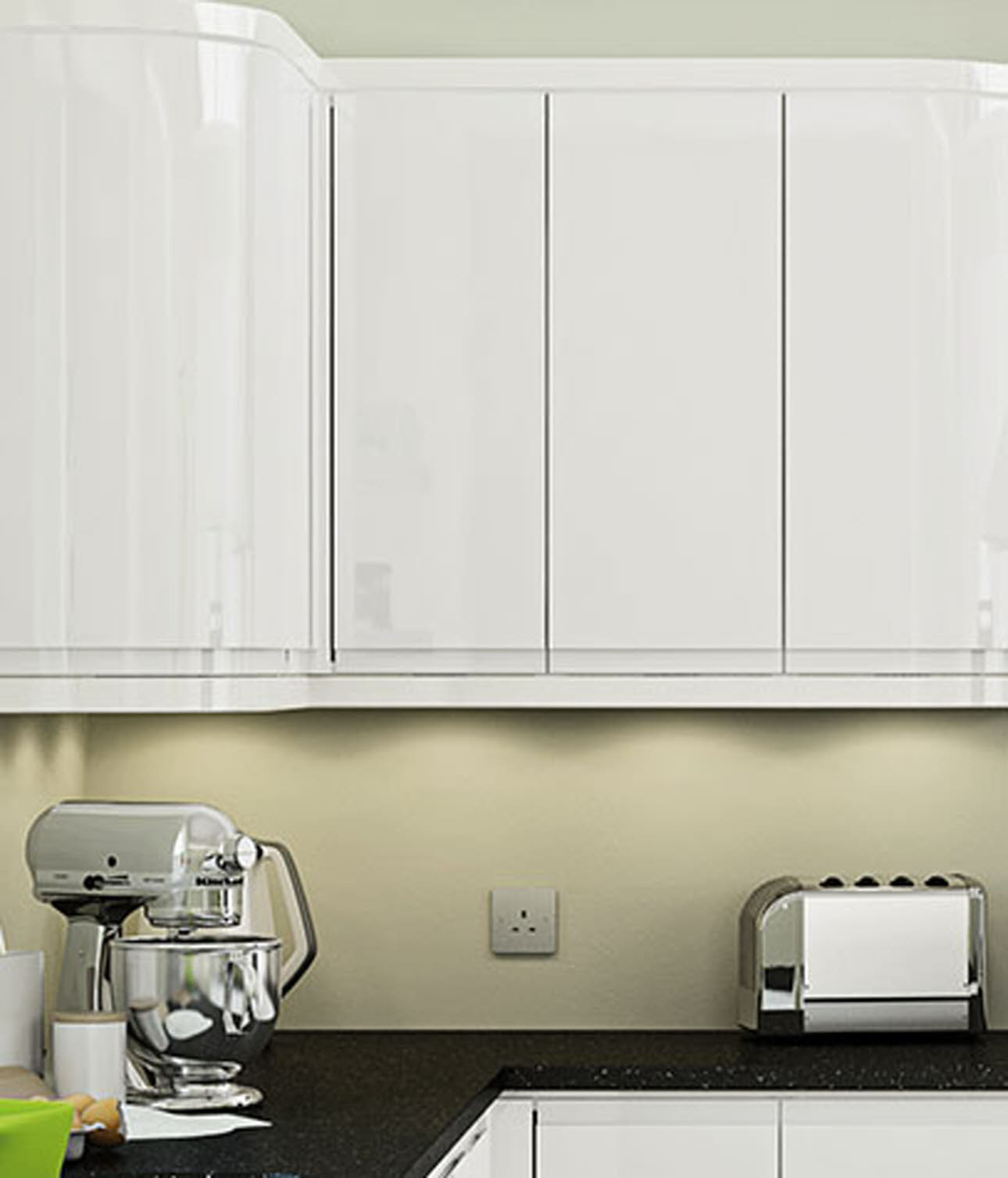 White kitchen wall mounted cupboards above black granite worktop