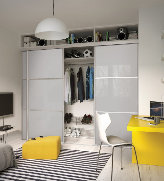 White fitted wardrobe with internal sliding door