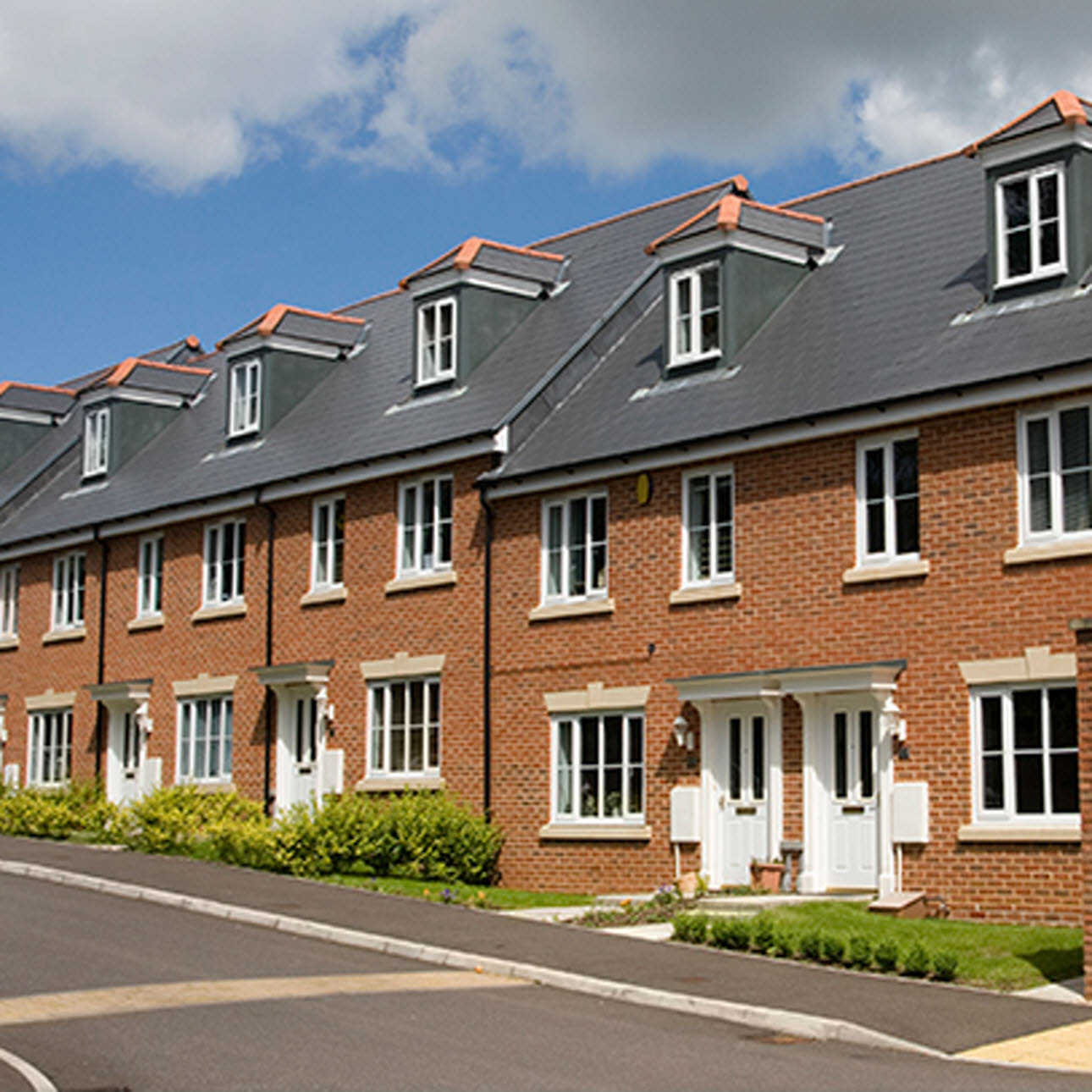 Exterior shot of a row of new build terraced houses